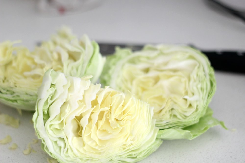 cabbage chopped on a white countertop to make homemade sauerkraut