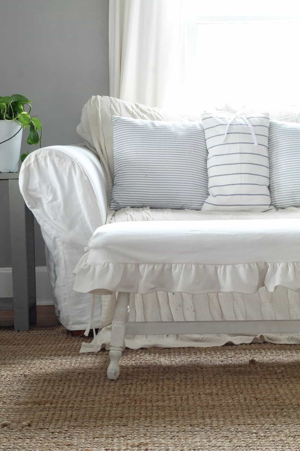 wooden bench with a DIY white drop cloth ruffle slipcover