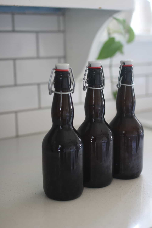 three amber bottles full of water kefit