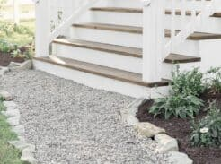 See how our farmhouse front porch steps look after we covered the concrete with wood