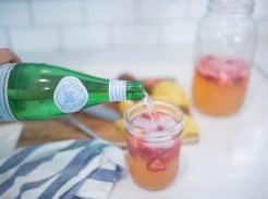 Learn how to make healthy homemade sparkling strawberry lemonade sweetened with honey