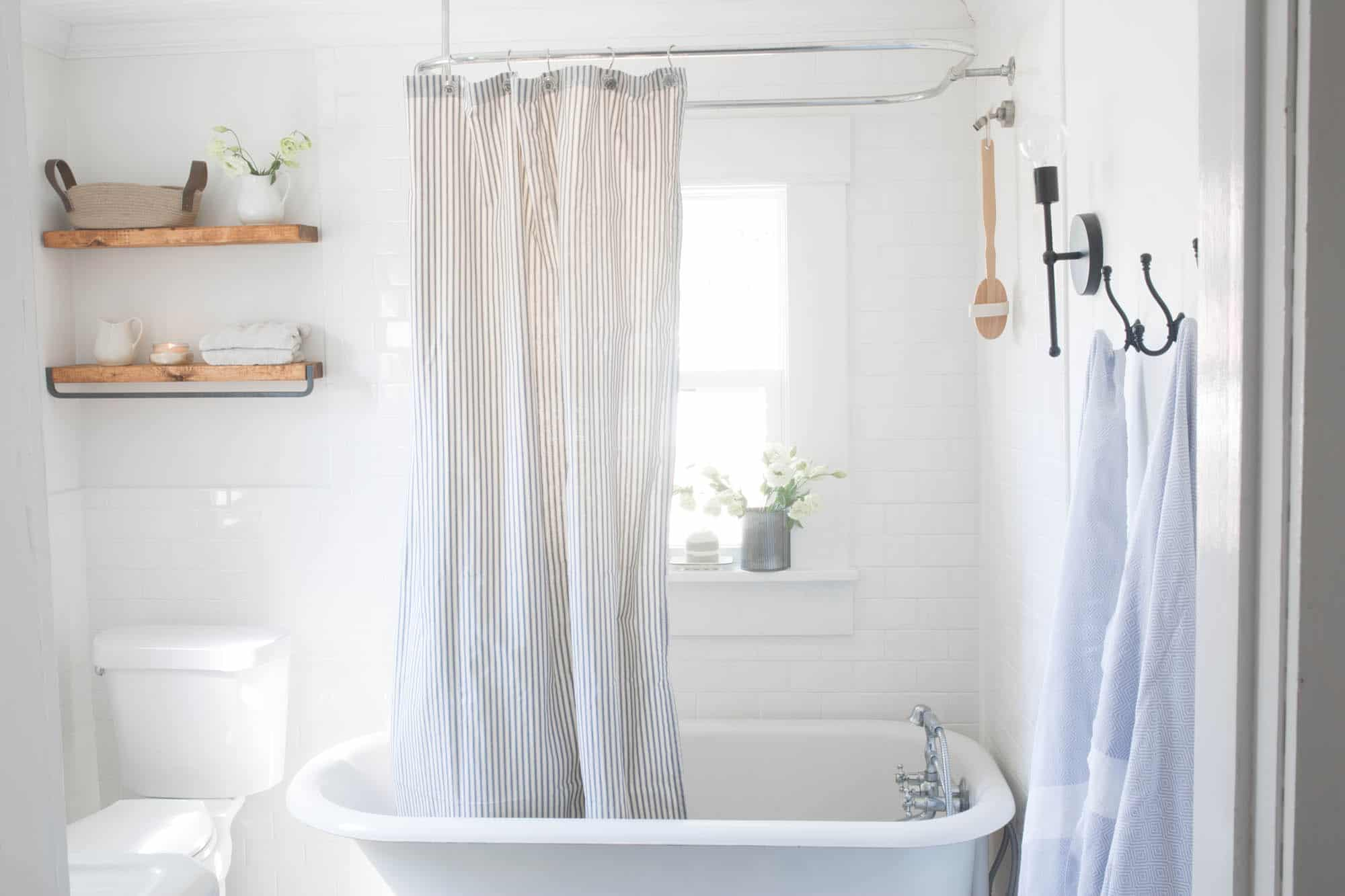 Farmhouse Bathroom Decor- Floating Shelves, Clawfoot Tub and Ironstone