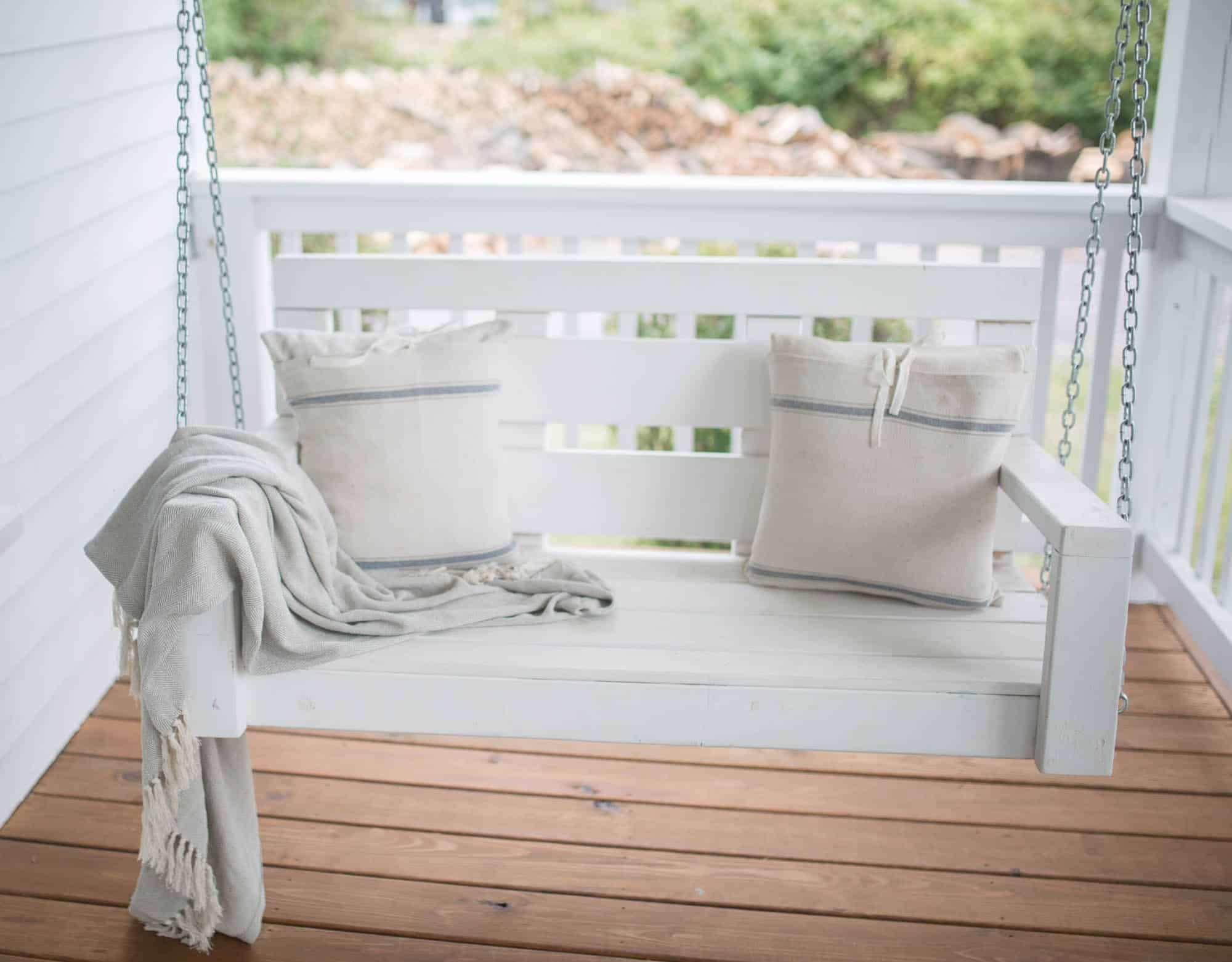 Fall Farmhouse Font Porch Swing with Grain Sack Pillows
