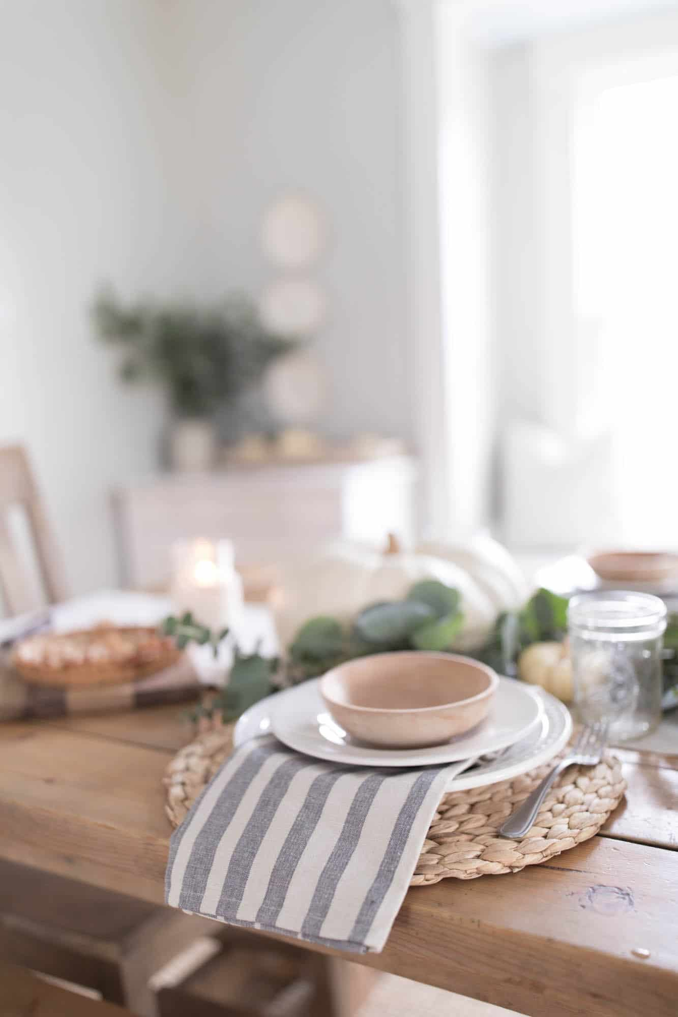 Thanksgiving Table Setting white and blue pumpkins and eucalyptus