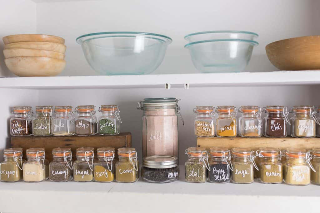 Spice Cabinet Organizing with glass jars and sharpie paint pen