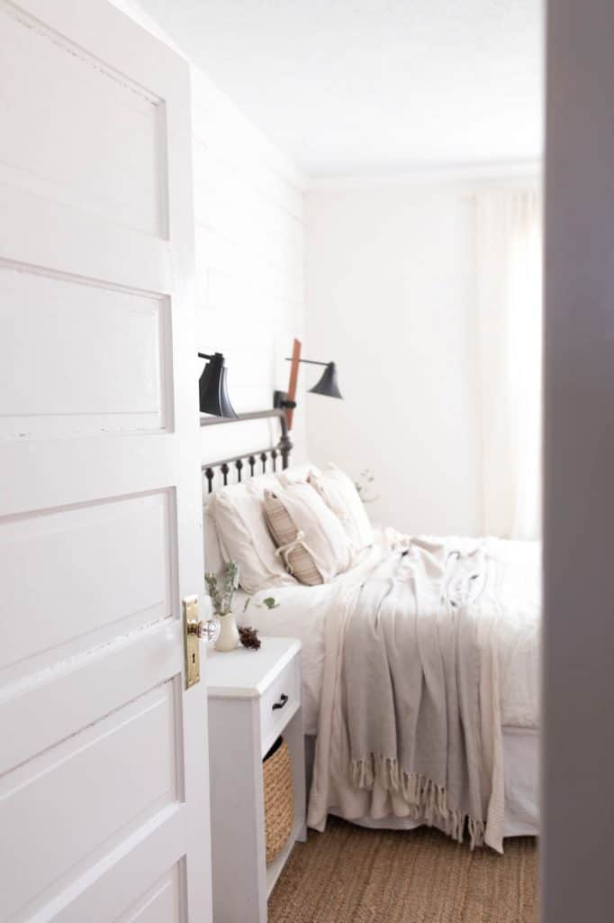Tour our winter farmhouse bedroom with lots of natural elements like greenery and pine cones.